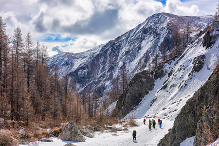 MUNCH-SARDYK, BURYATIA, RUSSIA - April 30.2016: Group of climbers goes on channel frozen river in mountains of Eastern Sayan. Climbing mountain peaks of East Siberia. Editorial
