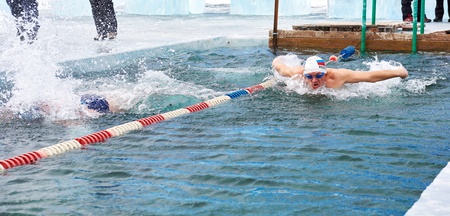 SAHYURTA ,, IRKUTSK REGION, RUSSIA - March 11.2017: Cup of Baikal. Interregional Winter Swimming Competitions. Butterfly is 25 meters. Mens