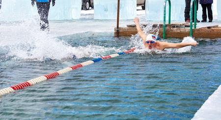 SAHYURTA ,, IRKUTSK REGION, RUSSIA - March 11.2017: Cup of Baikal. Interregional Winter Swimming Competitions. Butterfly is 25 meters. Mens