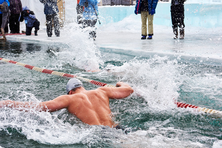 SAHYURTA ,, IRKUTSK REGION, RUSSIA - March 11.2017: Cup of Baikal. Interregional Winter Swimming Competitions. Butterfly is 25 meters. Men