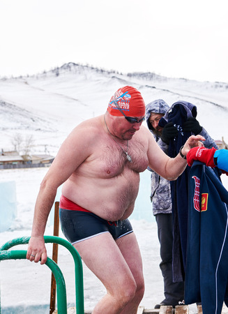 SAHYURTA, IRKUTSK REGION, RUSSIA - March 11.2017: Cup of Baikal. Winter Swimming Competitions. Alexander Brylin - record holder for longest distance overcome in ice hole