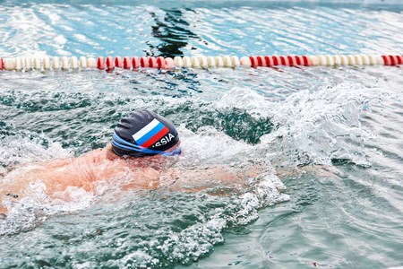 SAHYURTA, IRKUTSK REGION, RUSSIA - March 11.2017: Cup of Baikal. Winter Swimming Competitions. Breaststroke. Swimmers head above water according to rules of breaststroke style