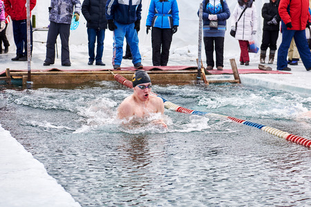 SAHYURTA, IRKUTSK REGION, RUSSIA - March 11.2017: Cup of Baikal. Winter Swimming Competitions. Breathe in swimmer Editorial