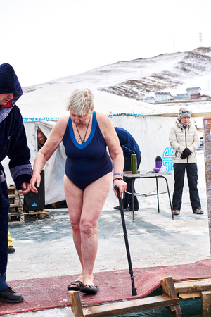 SAHYURTA, IRKUTSK REGION, RUSSIA - March 11.2017: Cup of Baikal. Winter Swimming Competitions. An elderly woman is contestant in cold water