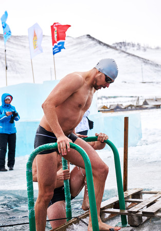 SAHYURTA, IRKUTSK REGION, RUSSIA - March 11.2017: Cup of Baikal. Winter Swimming Competitions. Swimmer after finish.