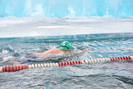 SAHYURTA, IRKUTSK REGION, RUSSIA - March 11.2017: Cup of Baikal. Winter Swimming Competitions. Breaststroke. Floating Alexander Zelenetsky - three-time world champion in winter swimming