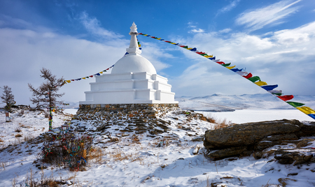 Enlightenment Stupa on island of Ogoy in early March. Irkutsk region. Olkhon area. Russia