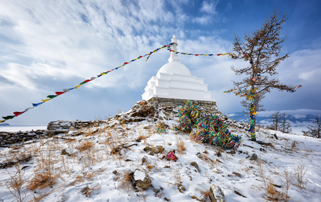 Enlightenment Stupa is the main type of Buddhist stupas. It symbolizes complete liberation from all human passions. Ogoy Island. Lake Baikal. Russia Stock Photo