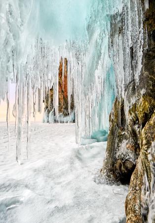 Sharp icicles hanging on coastal rock in early morning. Lake Baikal. Olkhon Island. Irkutsk region. Russia Stock Photo