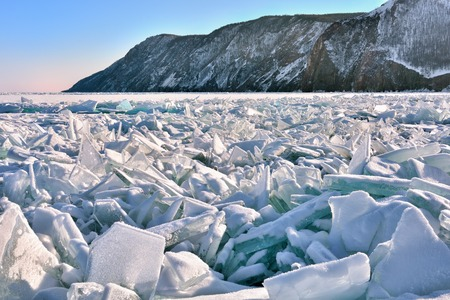Pile of large fragments of ice. Hummocks occurred as a result of destruction of ice by wind at freeze-up. Lake Baikal. Irkutsk region. Russia