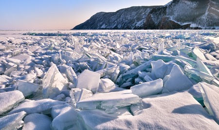 A large section of hummocks on ice of frozen lake. Baikal. Northern part island of Olkhon. Russia