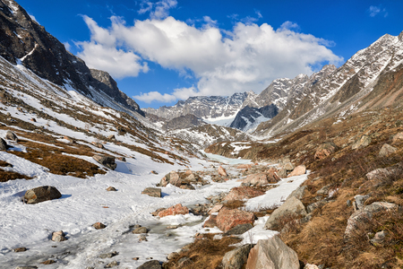 Valley of Muguvek brook. April month. Typical landscape of mountain tundra in Eastern Siberia. Sayan. Russia Stock Photo