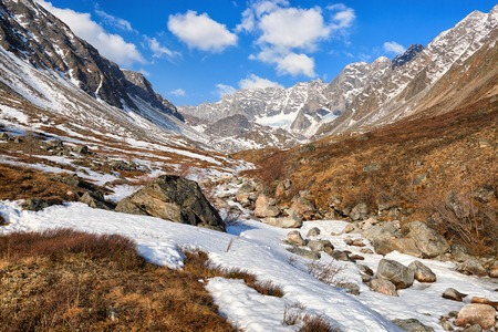Valley of small brook in mountains of Eastern Siberia. Sayan Mountains. Russia Stock Photo