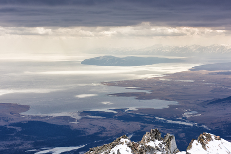 Lake Hovsgol from height of mountains. Low continuous cloud cover. Mongolian-Russian border.