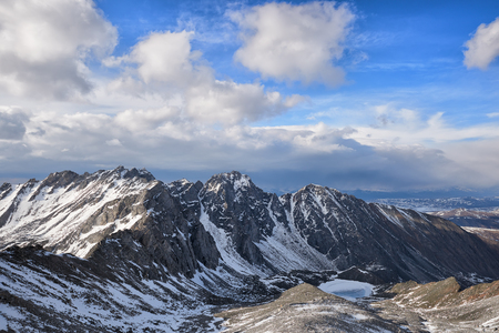 Cumulus clouds over a mountain massif. East Sayan. Russia Stock Photo