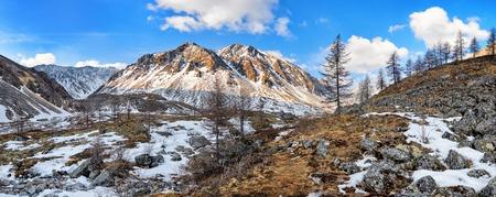 Nameless mountain peak and stream valley. Siberian alpine tundra in late April. Great Sayan. Munch-Sardyk. Russia