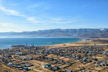Southern shore of Lake Baikal, Khamar-Daban Range and village Kultuk. Irkutsk region. Russia Stock Photo