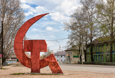 KYREN, BURYATIA, RUSSIA - April 30,2017: Sick and Hammer monument. Symbol of unity of workers and peasants. State emblem of Soviet Union and communist movement