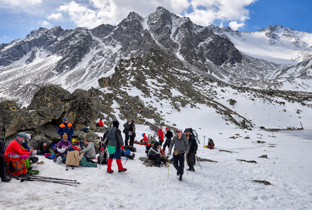 MUNKU-SARDYK, BURYATIA, RUSSIA - April 29, 2017: Climbers are resting at foot of mountain before rising to peak. Favorable weather promotes good mood among athletes Editorial