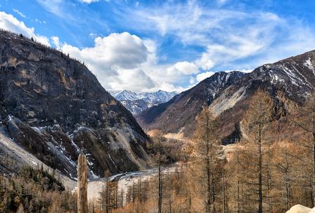 Narrow valley of Irkut River. In background is an array of Munku-Sardyk. Okinsky District. Republic of Buryatia. Russian Federation
