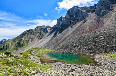 Beautiful little lake with an emerald shade of water in depths. Eastern Sayan. Southern Siberia. Russia Stock Photo
