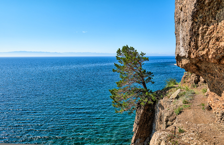 Devils bridge. Dangerous site of Great Baikal trail. Narrow passage punched in cliff face. Irkutsk region. Russia