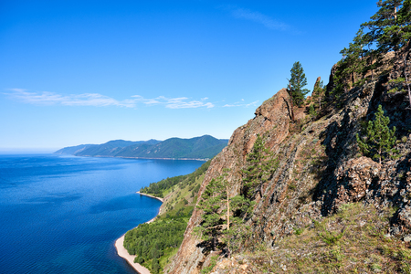 Scenic view of Lake Baikal from height of rock. Cliff is formed by conglomerates of Jurassic period. Great trail. Russia Stock Photo