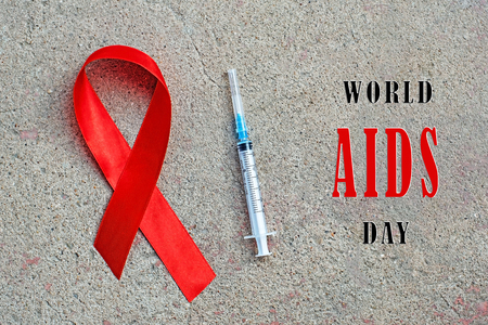 1st December, World Aids Day concept with shiny red ribbon awareness. Health and medicine Imagens