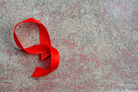 1st December, World Aids Day concept with shiny red ribbon awareness. Health and medicine Stock Photo
