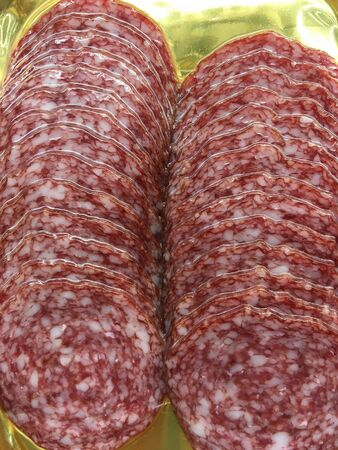 sliced sausage in vacuum packaging for close-up advertising