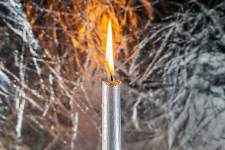 One candle is gray on a gray shiny background macro 版權商用圖片