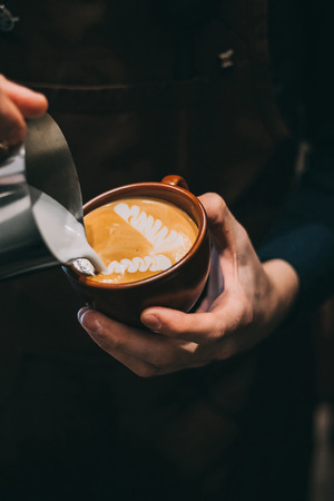 how to make latte art by barista focus in milk and coffee Stock fotó