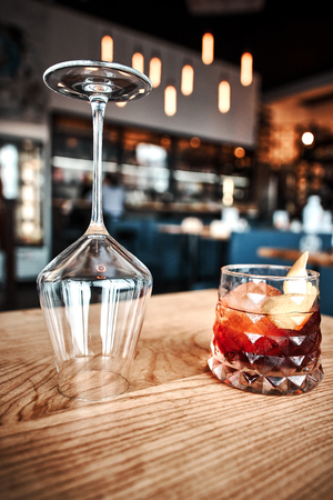 Negroni cocktail on dark wooden table