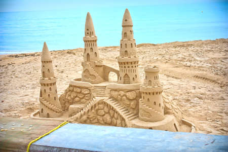 children sandcastle: sand castle built by the sea Stock Photo