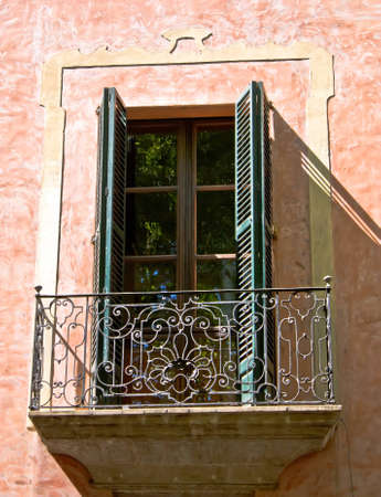Part of the building - a window with balcony - a Spanish style. photo