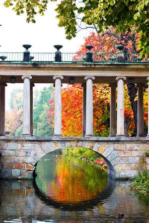 lazienki: bridge to royal palace on water.  Palace on the Island. Lazienki park, Warsaw, Poland