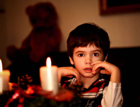 boy  with candle. light a candle photo