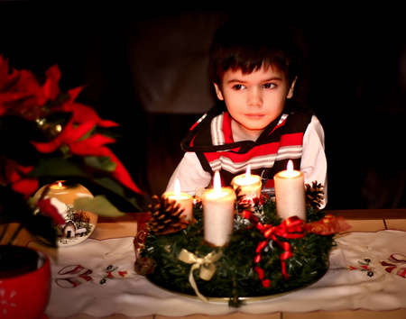 boy waiting for Santa Claus. The night. Spark. Christmas Ornaments photo
