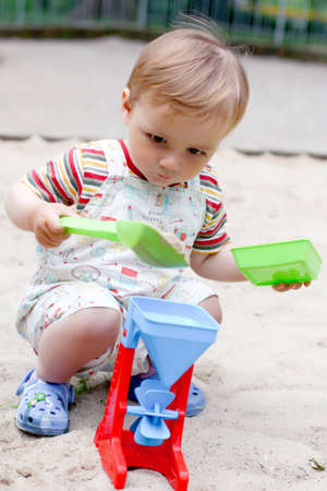 a little boy in the sandbox photo