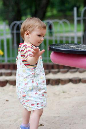 beautiful 1, 5 years  boy playing on the playground, summer Stock Photo - 12520997