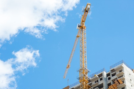 Tower crane on the construction of a residential house