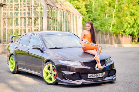 Moscow. Russia. May 26, 2015. Beautiful girl next to a racing, sports car. Foto de archivo - 104748898