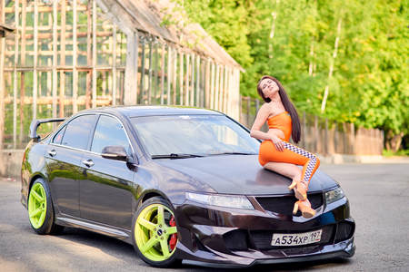 Moscow. Russia. May 26, 2015. Beautiful girl next to a racing, sports car. Foto de archivo - 104748901