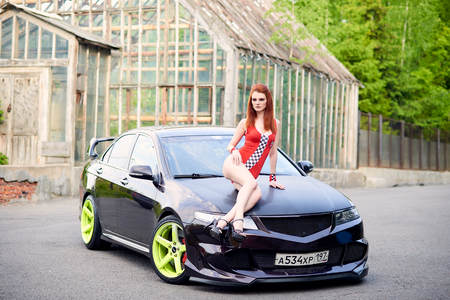 Moscow. Russia. May 26, 2015. Beautiful girl next to a racing, sports car.