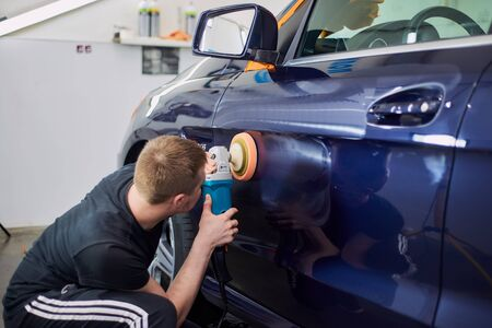 Moscow. Russia. May 29, 2018. A man polishes a blue Mercedes car ml. Editorial