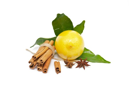 Lemon with foliage and spices