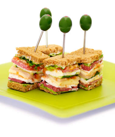 Snacks of Classical BLT Club Sandwich isolated on green plate Foto de archivo