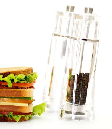 pepperbox: Classical BLT Club Sandwich with Saltcellar and pepperbox isolated on white background