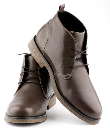 Zapatos de hombre de Brown aisladas sobre fondo blanco Foto de archivo