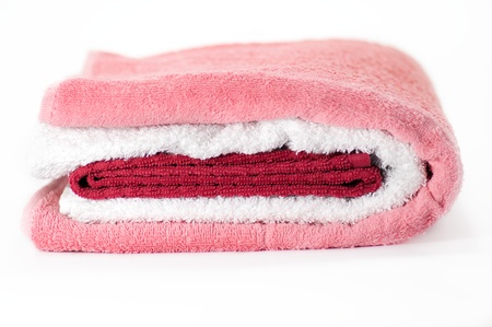 White, red and pink Terry towels isolated on white background photo